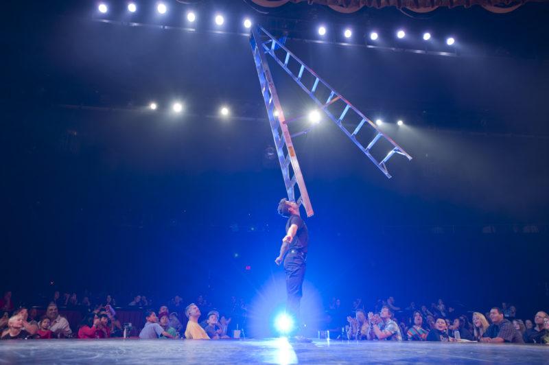 Jeff Civillico balances a ladder on his chin.