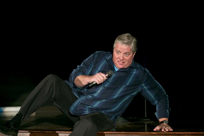 Tom Wilson sitting on stage