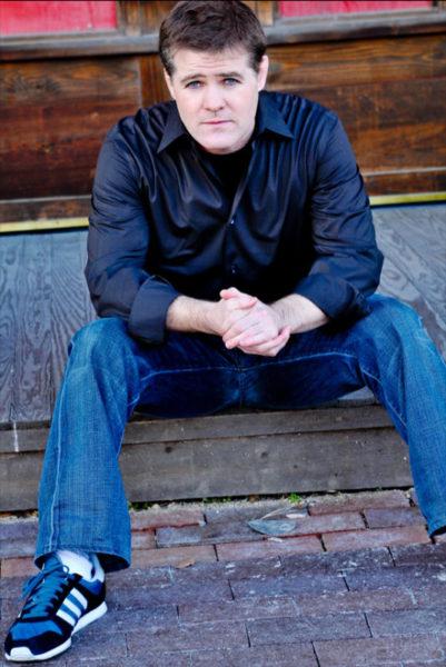 Comedian Greg Warren on steps